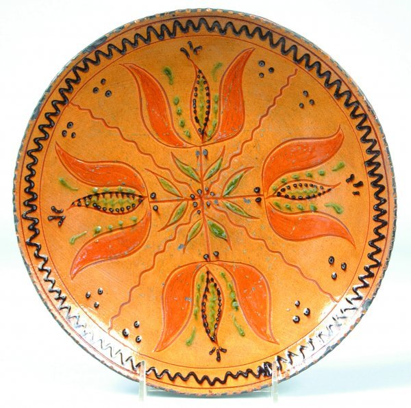 23: Greg Shooner 2003 Redware Plate having four floweri