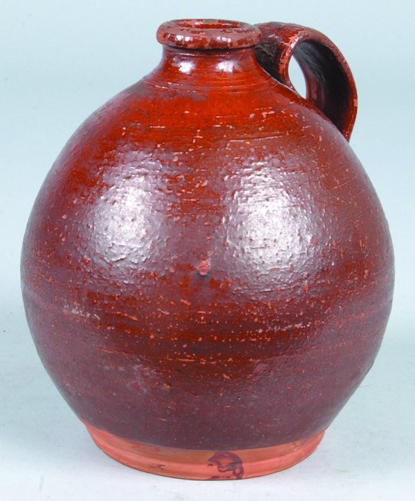 378: Redware Bulbous form Jug with applied handle and m