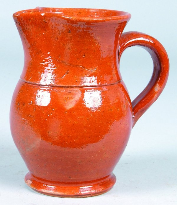 380: Redware Pitcher with Pinched spout and applied loo