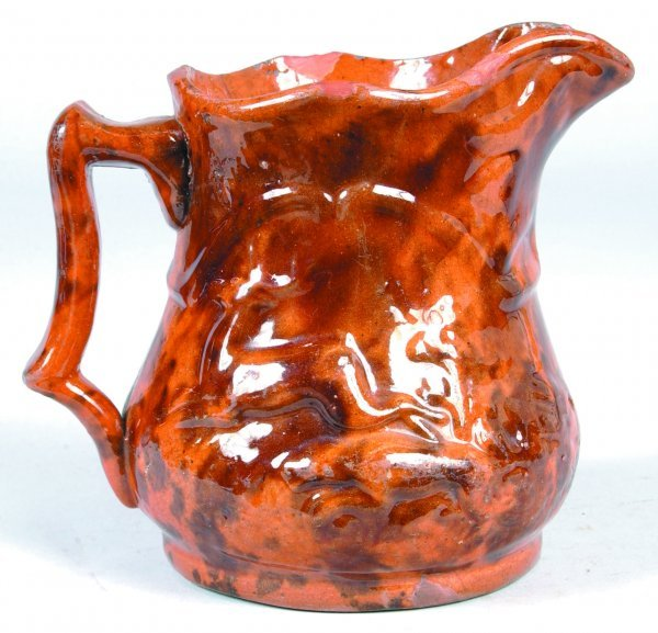 385: Redware Pitcher with embossed dog chasing stag, op