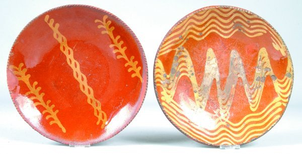 386: Two Redware Slip Decorated Plates, round form with