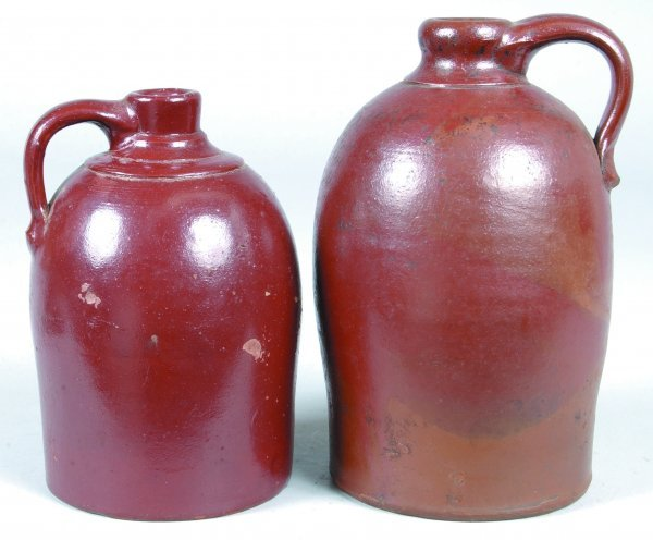 389: Two Redware Jugs with brown glaze, applied handles