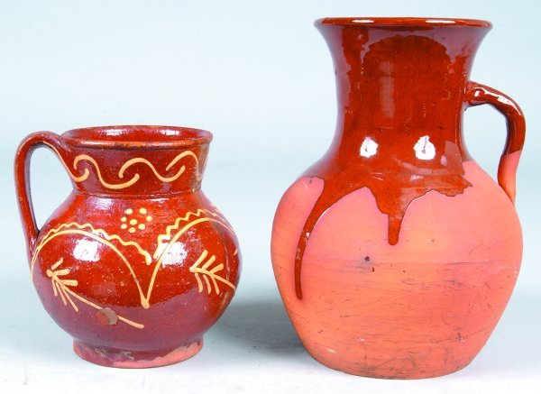 390: Two Redware Pitchers, first is slip decorated swag
