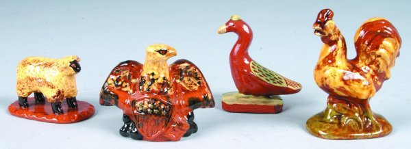 18: Four Redware Animal Figures, sheep, spread wing eag