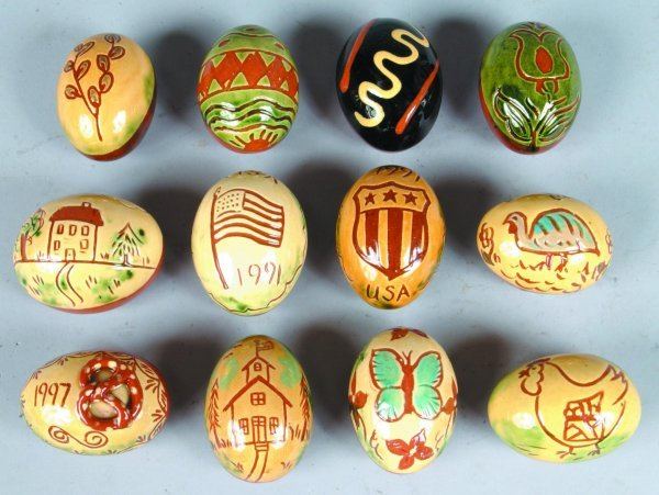 19: Twelve Breininger Redware Sgraffitto Decorated Eggs