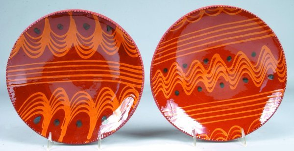20: Two C. N. Foltz Redware Slip Decorated Plates, wavy
