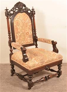 Victorian Walnut Carved and Molded Armchair.