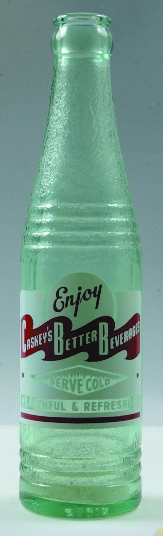 14: Caskey's Better Beverages clear crown top soda bott