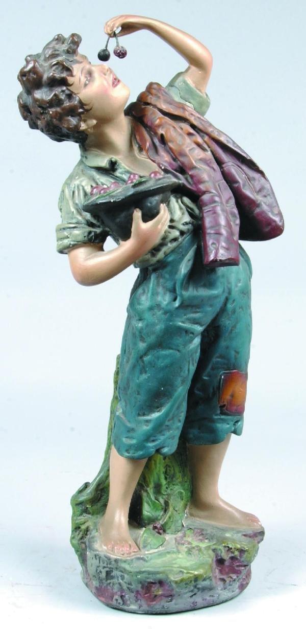 480: Plaster of Paris Cherry Boy Sculpture, boy holding