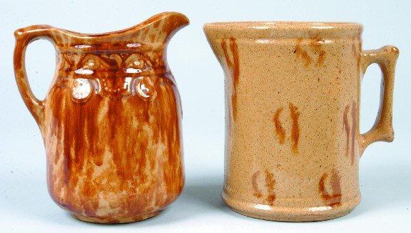 369: Two Glazed Yellowware Milk Pitchers; smoke-ring