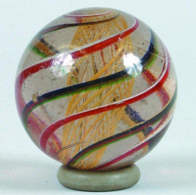 4: Large Transparent Swirl Marble with yellow latticini