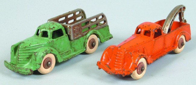 9: Two Hubley Cast iron Trucks white rubber balloon tir