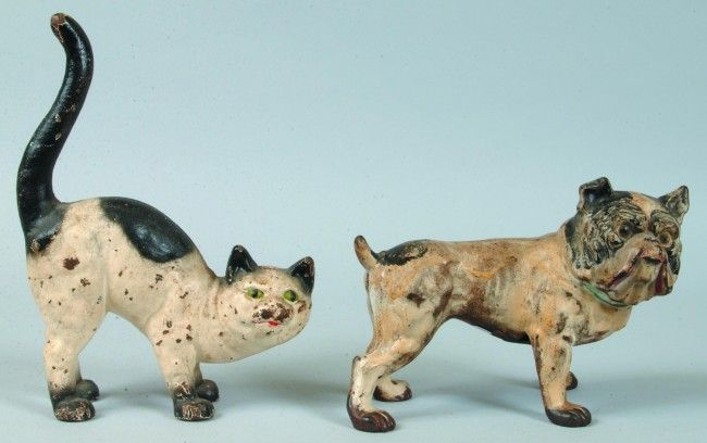 91: Two Hubley Cast Iron Doorstops; Standing Cat with o