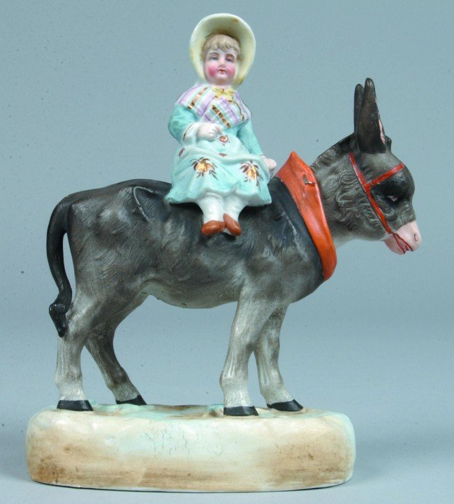 10: Late 19th Century Hand Painted Bisque Girl on Donke