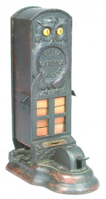 314: Cast Iron Coin Operated Match Dispenser; relief de