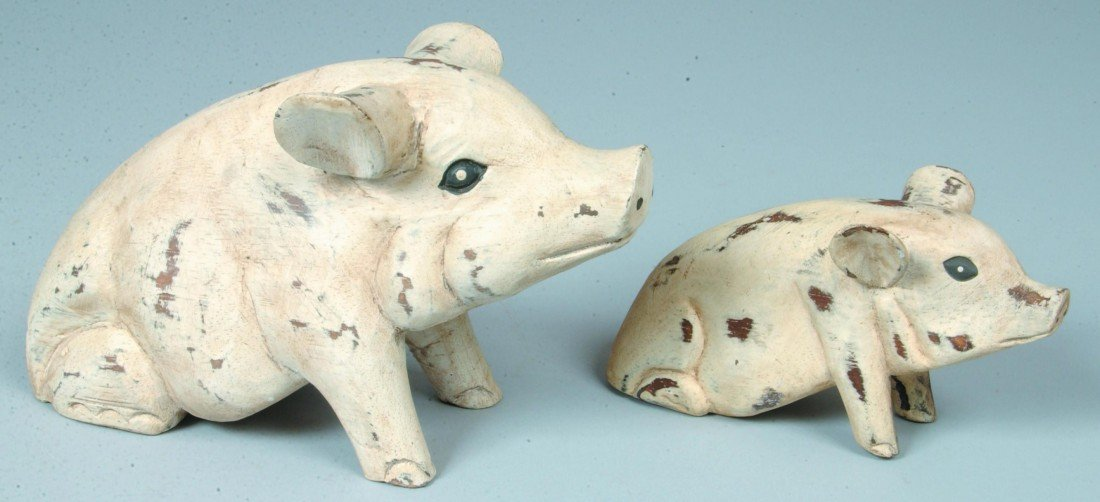 3: Two White Painted Carved Wood Pigs; seated, black ey