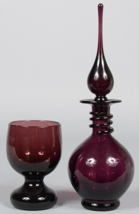 6: Two Pieces Amethyst Blenko, decanter with neck wrap