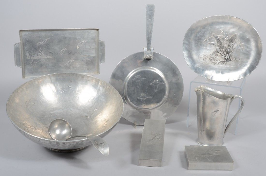 Eight Pieces of Aluminum with embossed flying ducks