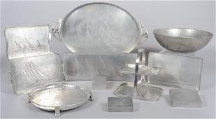 61: Ten Pieces of Aluminum with various Boat Designs by