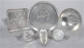 75: Six Pieces of Aluminum with Embossed Parrot Design