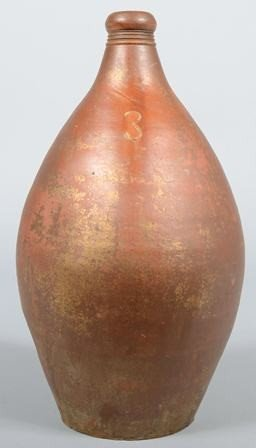 738: Ovoid Stoneware Jug with applied loop handle. Thre