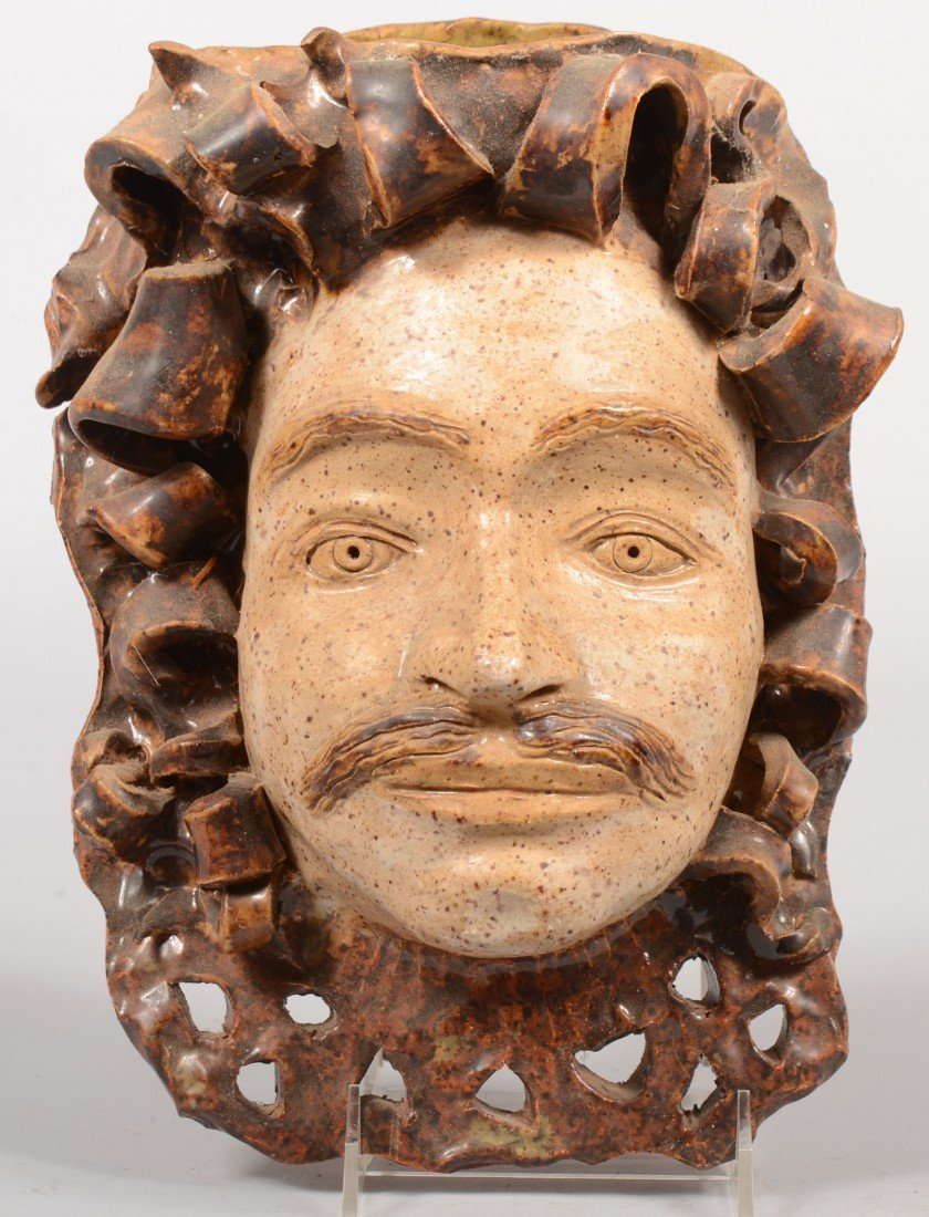 6: Ceramic Mask Wall Pocket. Mustachioed man's face in