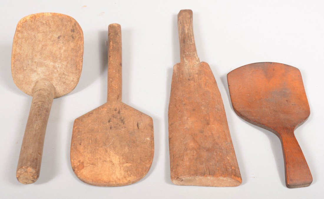 23: Four Carved Wooden Kitchen Paddles. Mixed woods, in