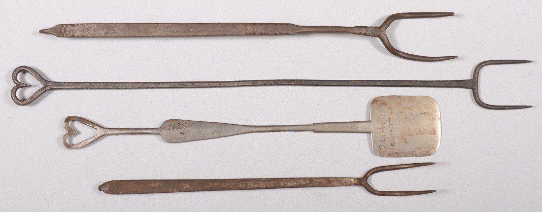 121: Four Decorative Wrought Iron Utensils. A spatula w