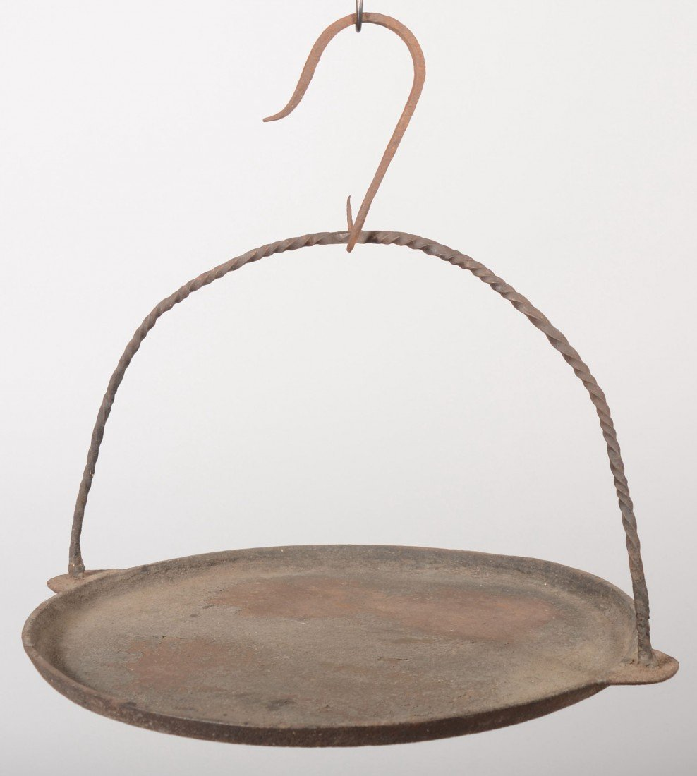 123: Hanging Cast Iron Griddle. Round pan has hanging e