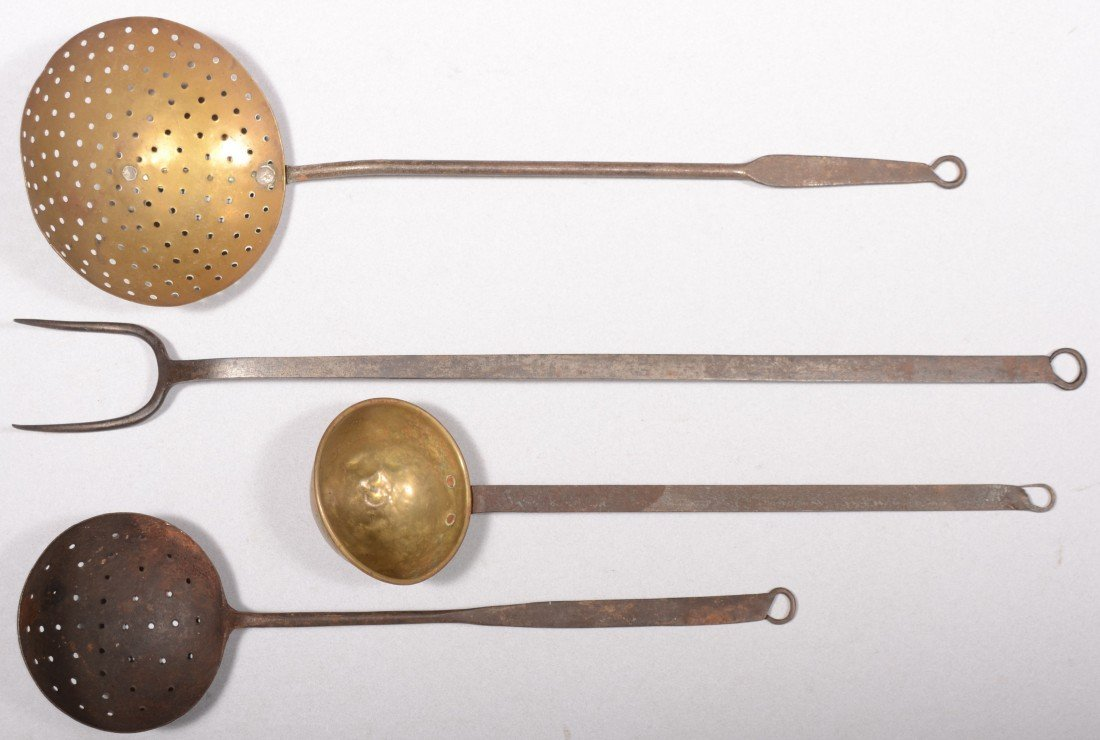127: Four Wrought Iron Utensils. A dipper with brass bo