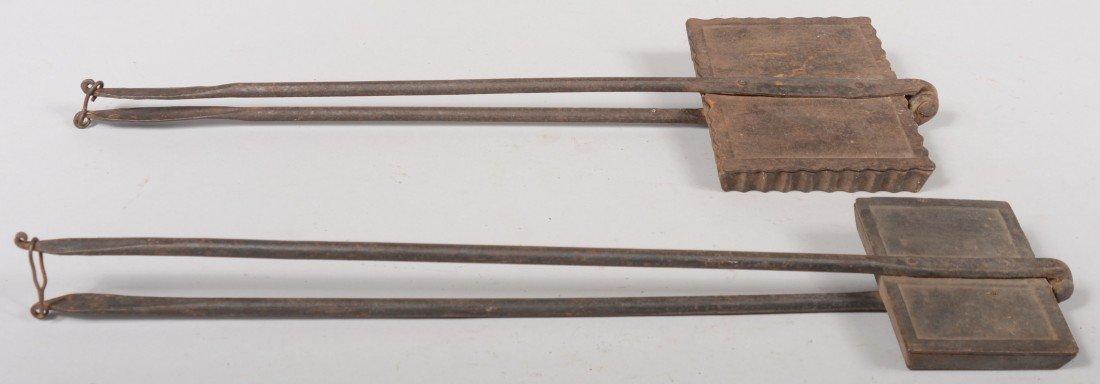 140: Two Cast Iron Waffle Irons. Smaller has plain squa