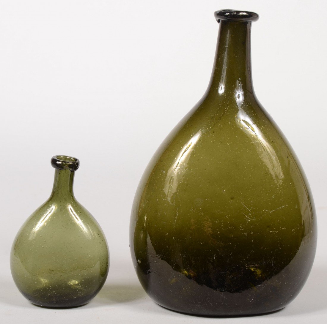 180: Two Blown Olive Green Glass Chestnut Bottles, ovoi