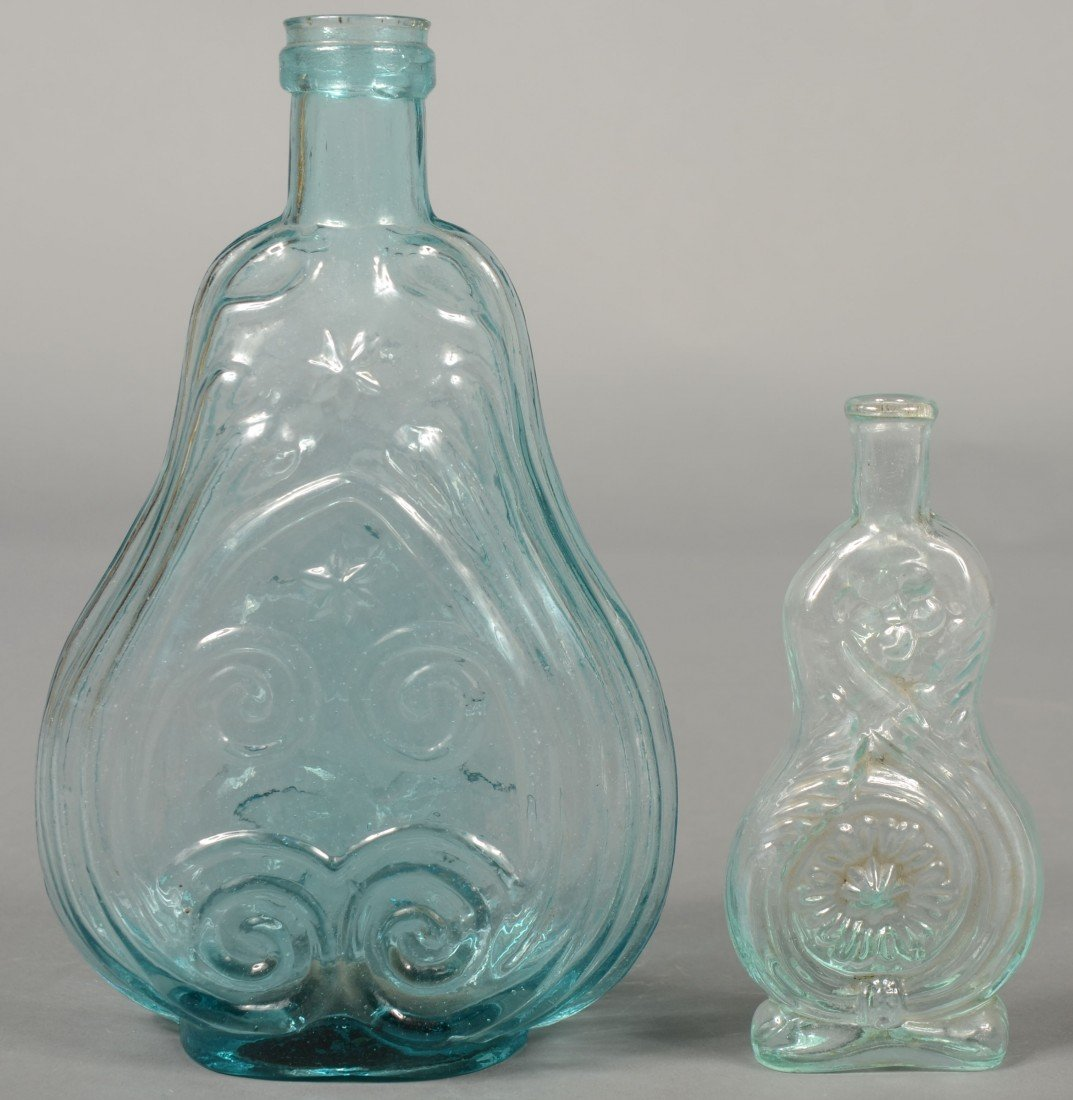194: Two Aquamarine Glass Bottles; 1st is a quart size