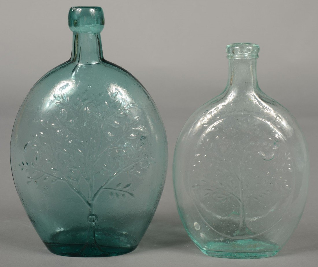 "203: Two Aquamarine Glass Flasks; 1st is a pint size ""S"