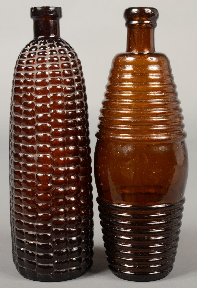 207: Two Amber Glass Bitters Bottles; 1st is a maze for