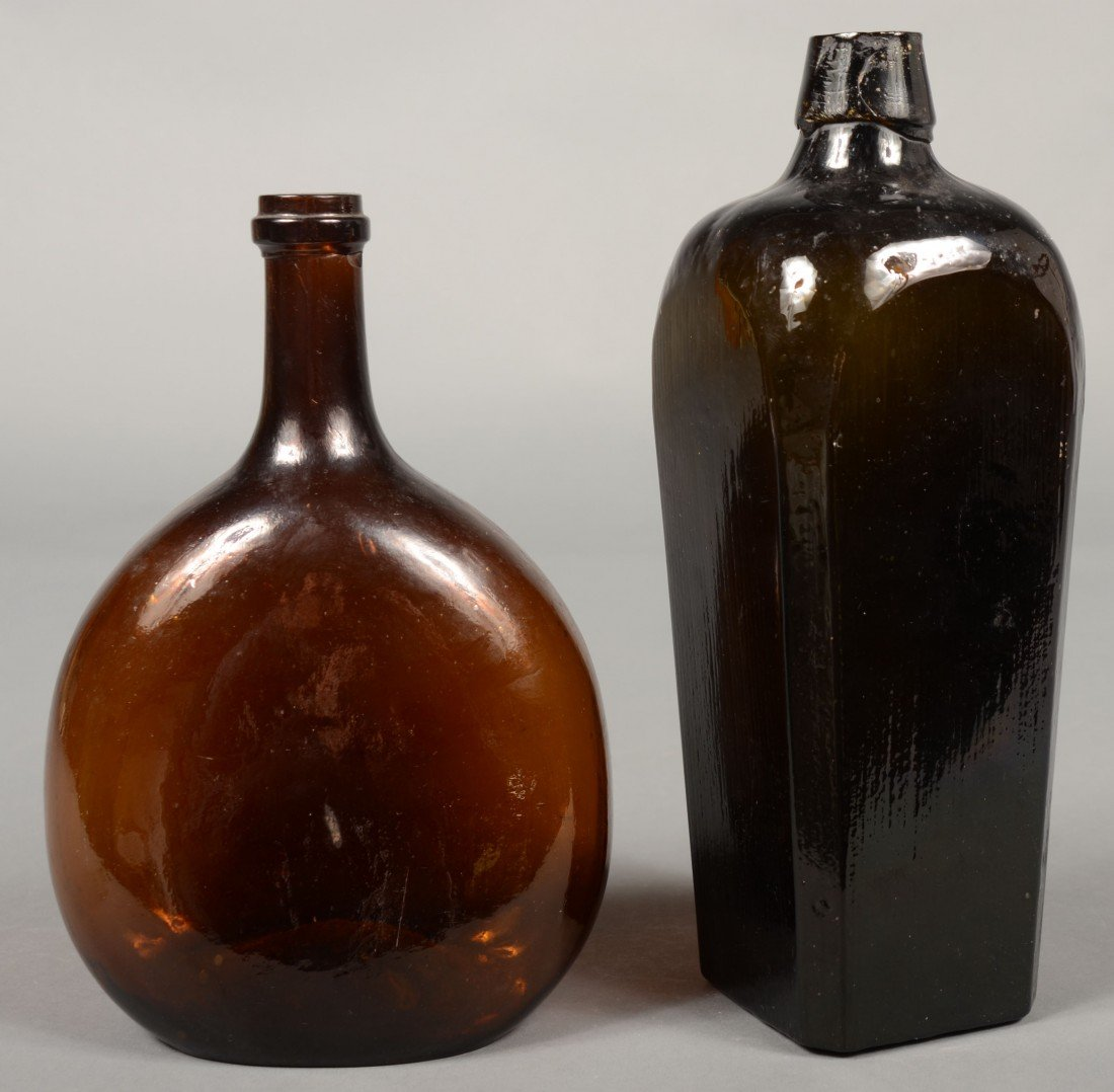209: Two Blown Glass Bottles; 1st is a amber glass ches