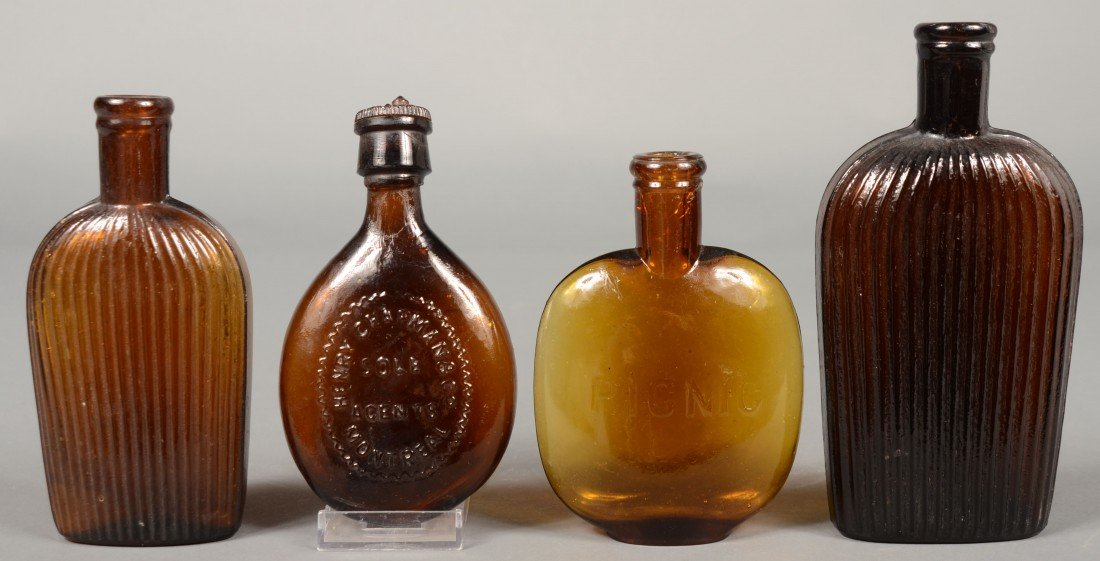 219: Four Amber Glass Pocket Flasks including two verti