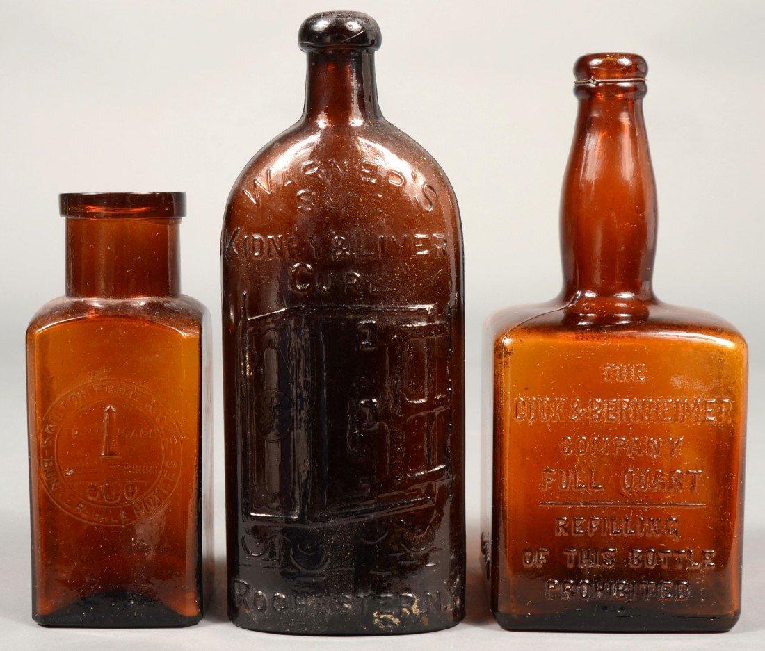 "226: Three Amber Glass Bottles; 1st- ""WARNER'S SAFE KID"