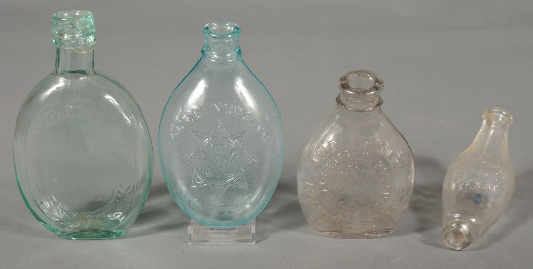 228: Three Nursing Bottles and a Half Pint Wreath Flask