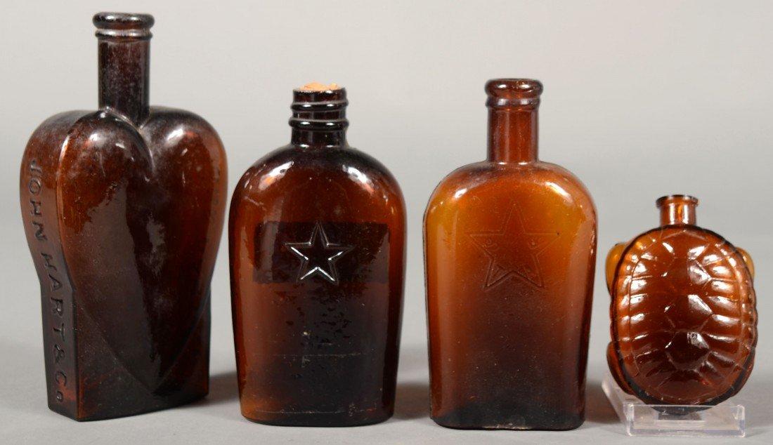 """229: Four Amber Glass Bottles including """"JOHN HART & CO"""
