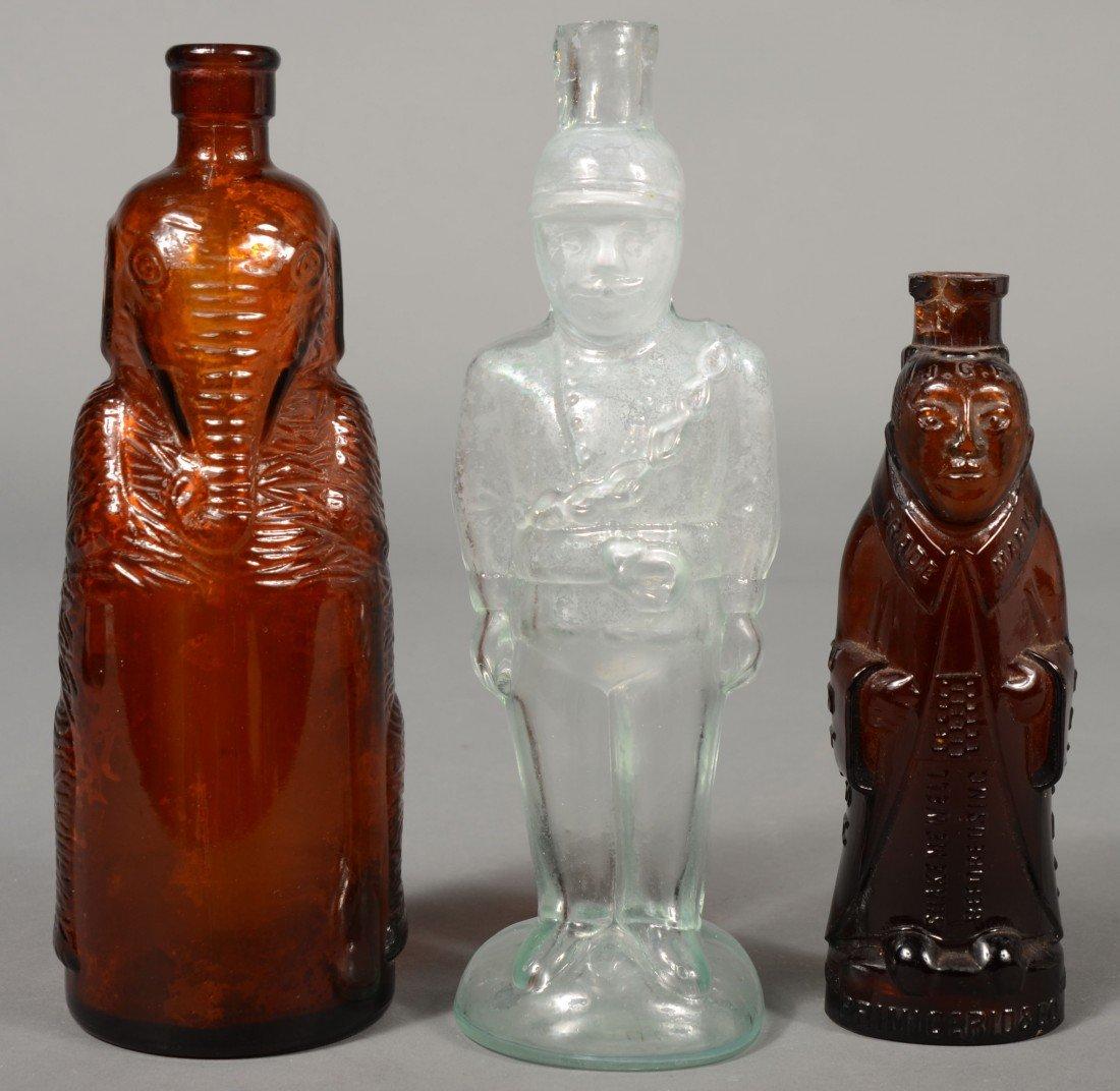 230: Three Figural Bottles; 1st- amber glass elephant f