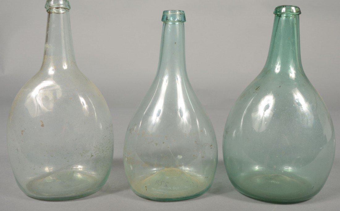 231: Three Aquamarine Blown Glass Wine Bottles, Bulbous