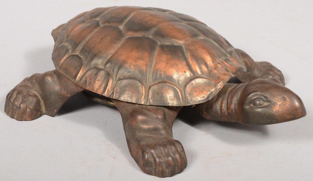 551: Lift Shell Tortoise Spittoon. Mechanical copper pl