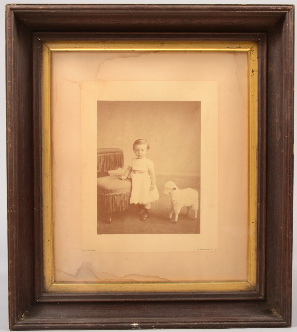 22: Sepia Photograph of a Young Girl with Toy. Studio p