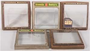 "270: Five Metal Cracker Box Lids. Two green labeled ""Un"