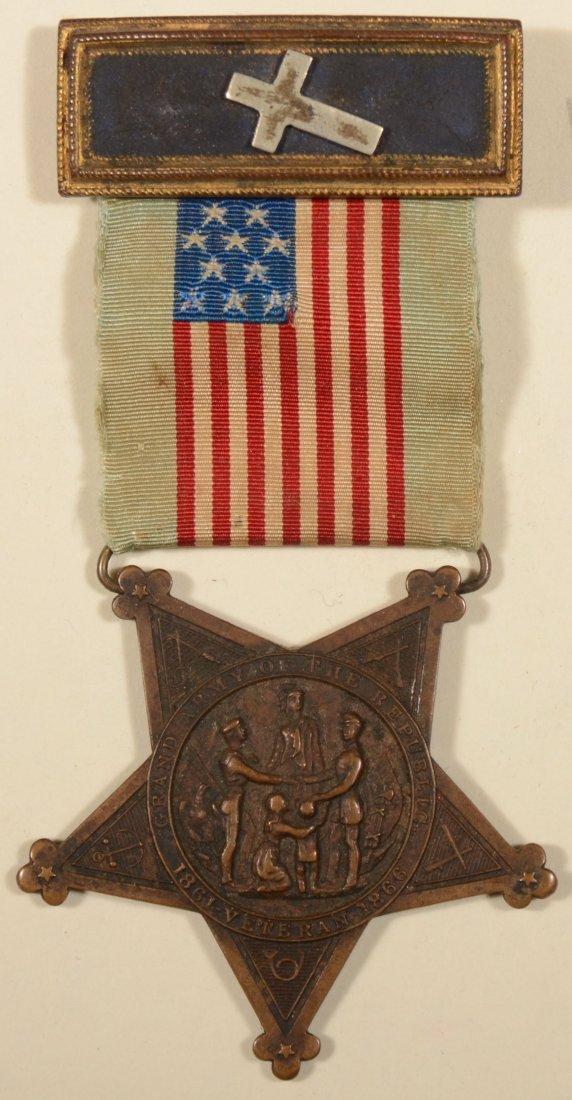 13: GAR Membership badge having an officer strap with a