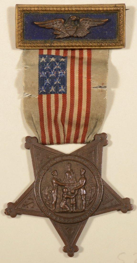 15: GAR Membership badge having an officer strap with a