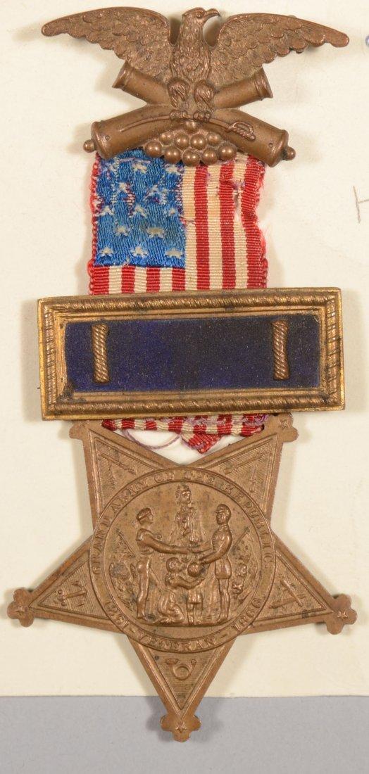 16: GAR Membership badge having an officer strap with L