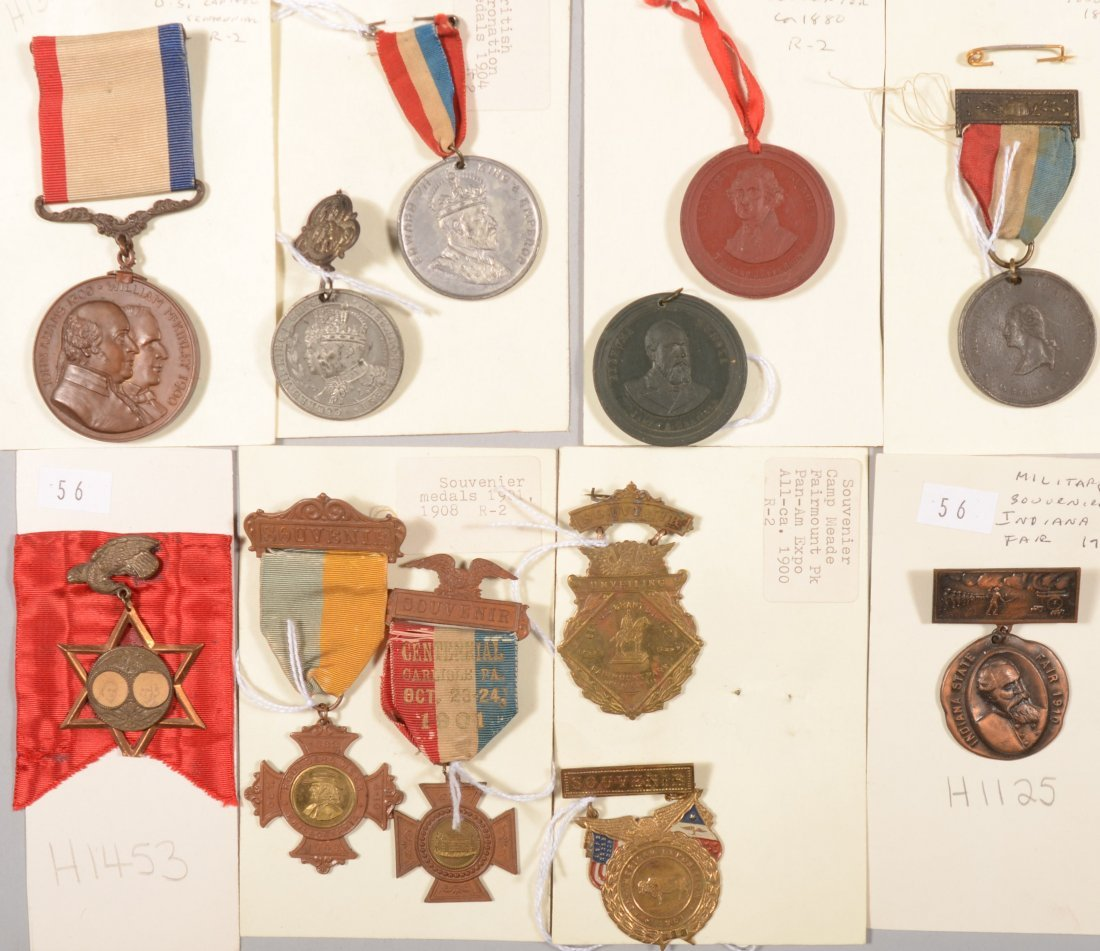 56: Lot of (12) various souvenir medals 1889 to 1910.