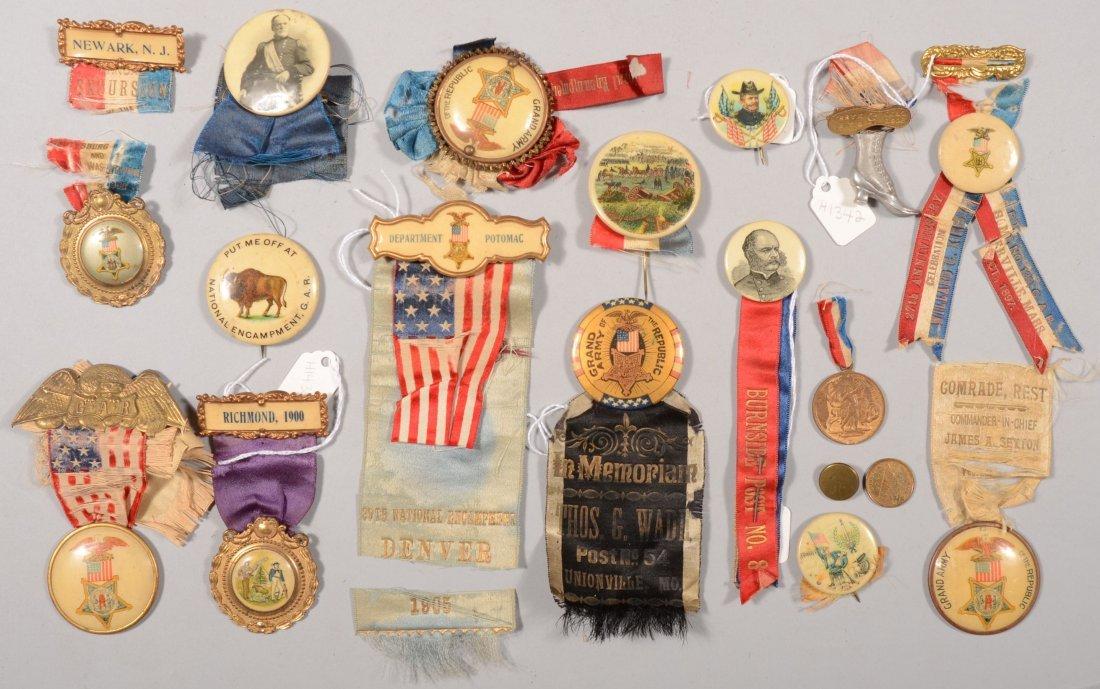 57: Assortment of veteran and GAR pendants and pinback